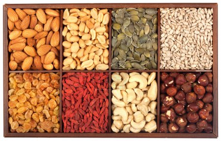 Photo for Healthy food organic nutrition.Wooden box full of raw seeds and nuts isolated on white backgroun - Royalty Free Image
