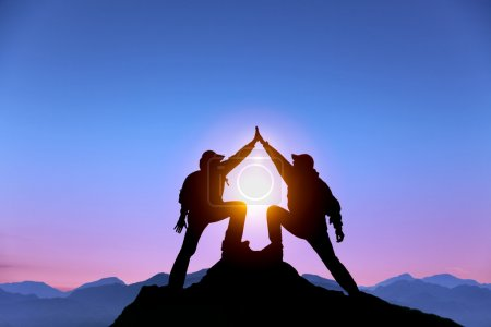 Photo for The Silhouette of two man with success gesture standing on the top of mountain - Royalty Free Image