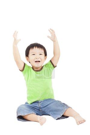 Photo for Happy boy raising hand - Royalty Free Image
