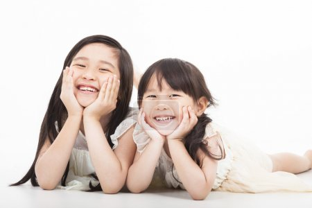 Happy two asian girls on the white background...