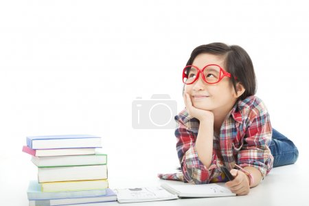 Asian little girl thinking during preparing homework