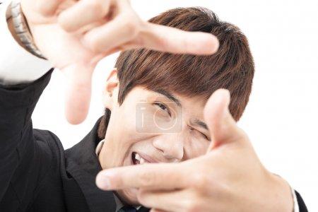 Photo pour Heureux homme cadrage photo sur fond blanc - image libre de droit