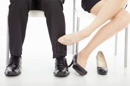 affections between business man and woman in office