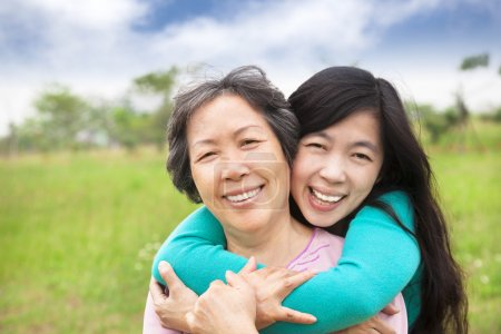Photo for Young woman hugging with her mother - Royalty Free Image