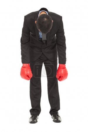 Businessman no energy and courage to attend boxing game .