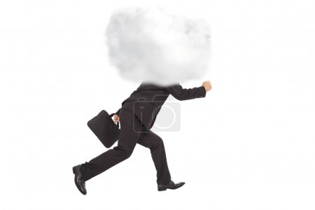 Young businessman running with head in the clouds