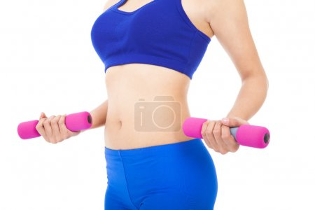 Woman's body part with fitness dumbell over white...