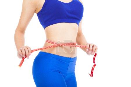 Photo pour Femme sportive formes et mesure sur fond blanc - image libre de droit