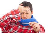 Kranken jungen Mann Fieber Messtemperatur mit thermometer