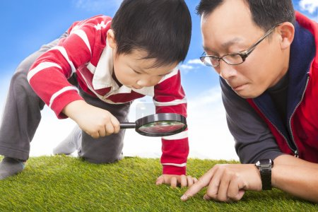 Photo for Father and kid with magnifying glass to discover - Royalty Free Image