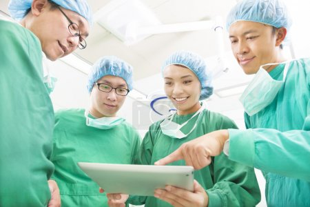 Happy Surgeons discussing success operating procedure