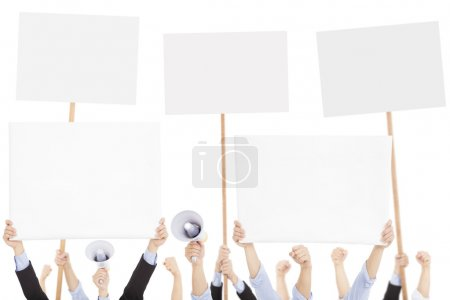 Photo for Furious people protesting with board and megaphone - Royalty Free Image