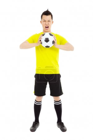 Soccer player exclaimed and holding a soccer