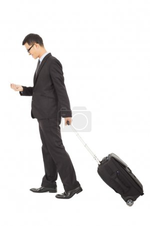 businessman walking and using phone  with briefcase