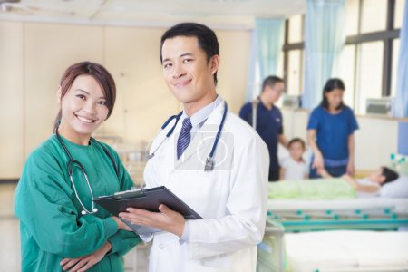 smiling doctor and assistant with patient