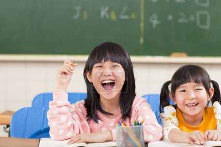 Photo for Happy children in the classroom - Royalty Free Image