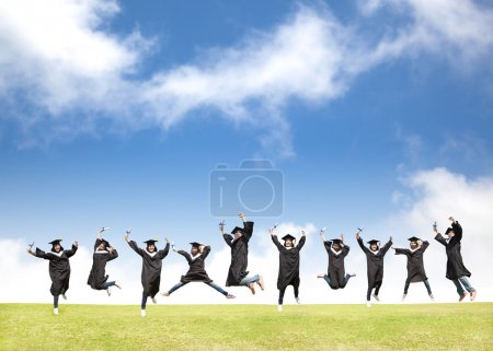Photo for College students celebrate graduation and happy jump - Royalty Free Image