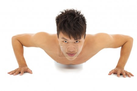 smiling Young man make push-ups and fitness