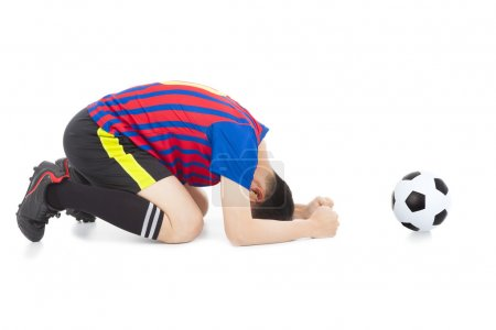 soccer player lose the game and kneel down