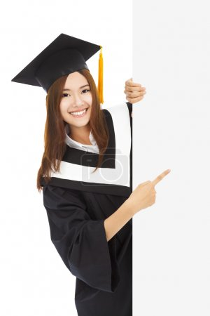 Photo for Young female graduation students point to  blank board - Royalty Free Image