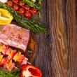 Raw fresh meat on cutting board with condiments an...