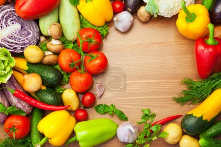 Fresh Organic Vegetables on wooden Table - Round