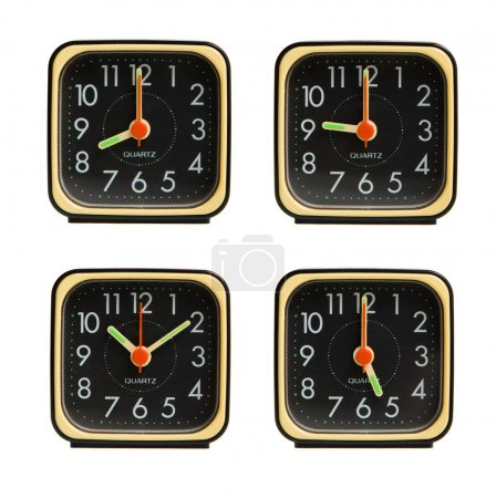 Small clocks showing various time of the day