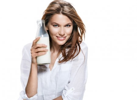Satisfied european woman & bottle of milk - isolated on white background