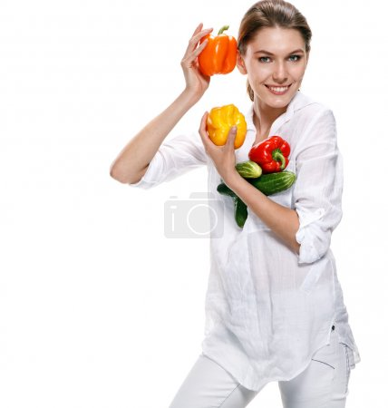 Promo girl holds red and orange paprikas - isolated on white background