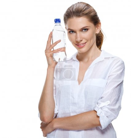 Smiling beautiful woman with bottle of water isolated on white