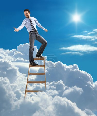 Young confident businessman standing at the top of ladder high in the sky lends a helping hand