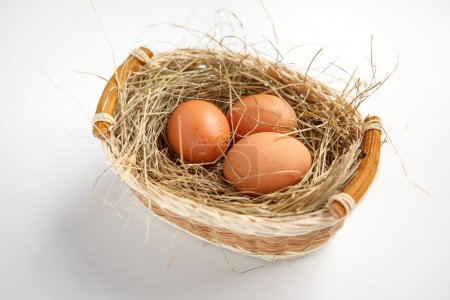 Basket with brown chicken eggs