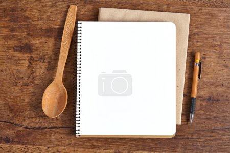 Photo for Studio photography of wooden kitchen spoon and pencil on wood table background - Royalty Free Image