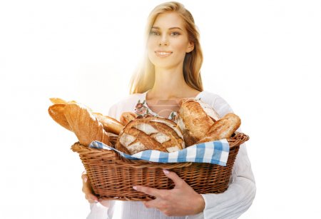 Pleasing woman with bread and rolls