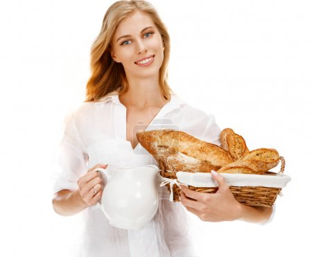 Traditional woman with bread and white carafe