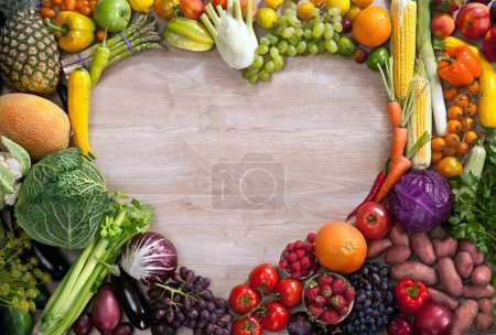 Photo for Food photography of heart made from different fruits and vegetables on wooden table - Royalty Free Image