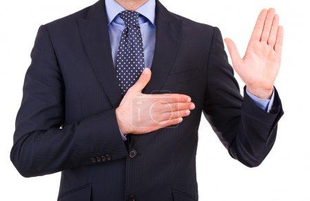 Businessman taking oath.