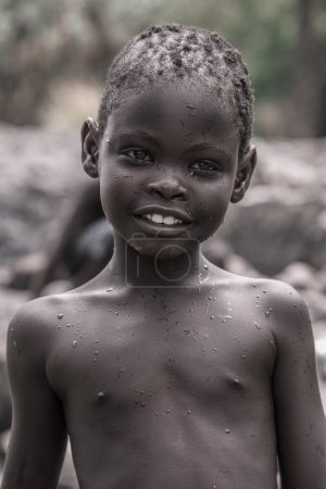 Portrait of a young kid of the Himba tribe, Namibia