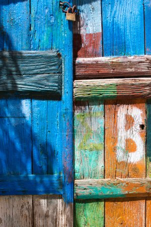 Close-up of a painted door with a lock