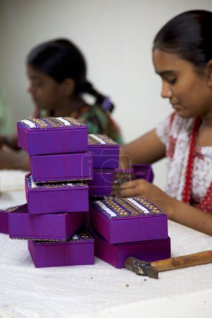 Woman artisan working on on fair trade artifacts in India