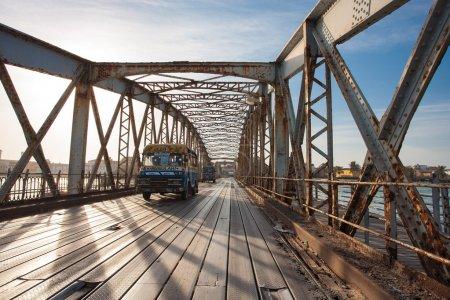 Public bus crossing the Faidherbe Bridge in Saint Louis