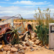 Old and rusty car wreck at the last gaz station be...