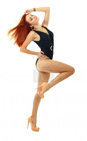 Photo for Beautiful model in black swimsuit posing or dancing over white background - Royalty Free Image
