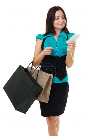 Woman reading receipt after good shopping