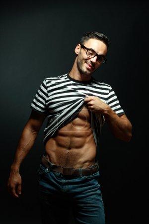 Smart muscular man in glasses