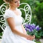 Portrait of beautiful romanitic woman bride sittin...