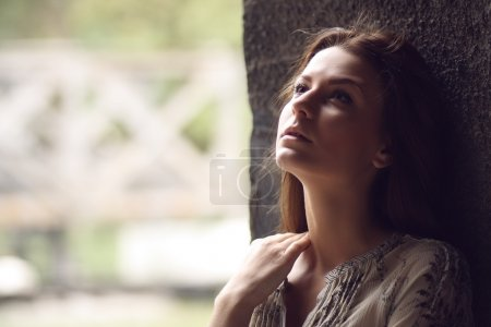 Photo for Outdoor portrait of a sad teenage girl looking thoughtful about troubles - Royalty Free Image