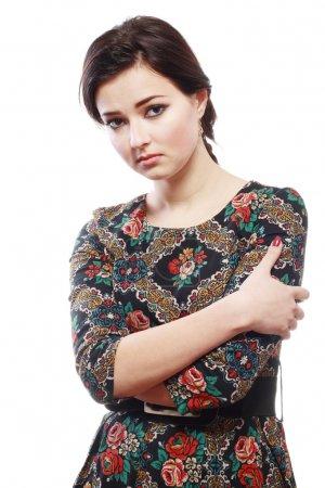 Photo pour Portrait of unhappy looking brunette beauty on white background. - image libre de droit
