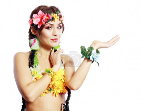 Photo for Beautiful exotic girl with Hawaiian accessories showing open palm with space for your product or text - Royalty Free Image