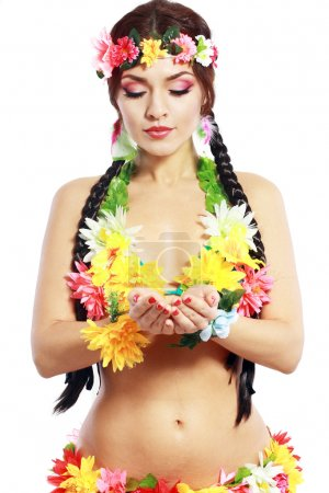 Photo for Beautiful exotic girl with Hawaiian accessories hold something in her hands - Royalty Free Image
